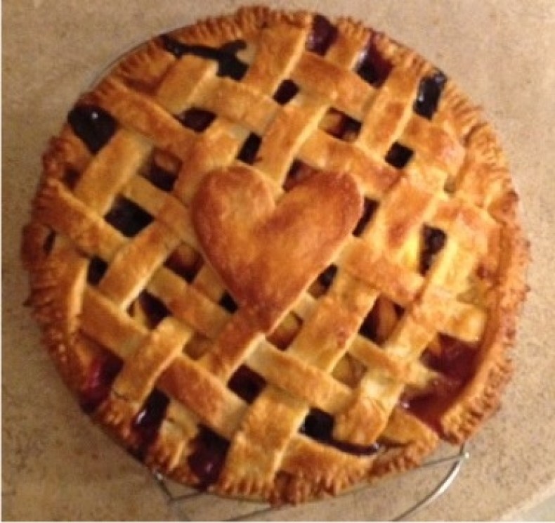 Peaches and blueberry lattice topped pie with a buttery crust.