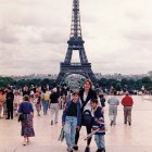Lovely family in front of the Eiffel Tower in Paris.