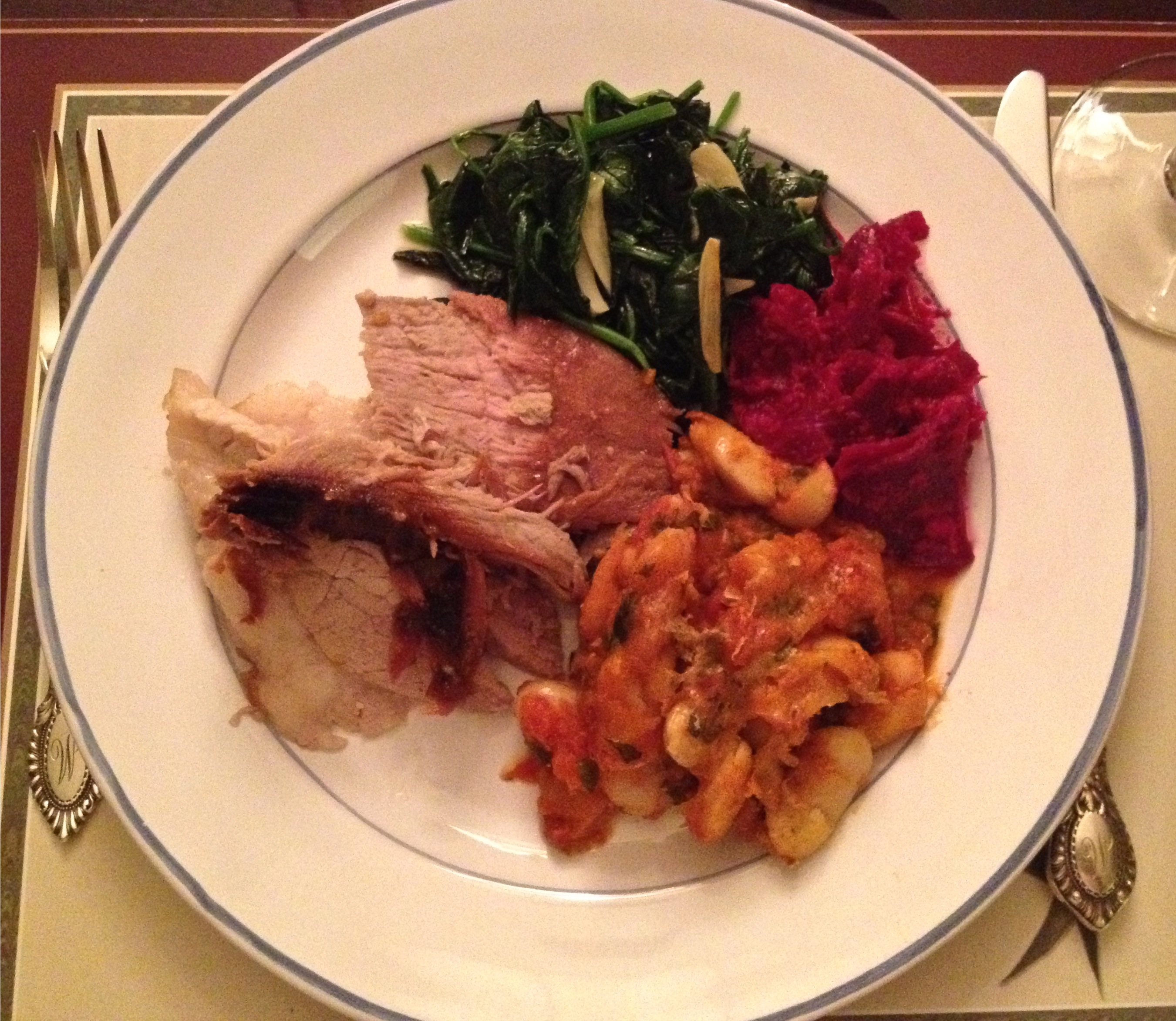Easter dinner plate with baked ham beans beets and sautéed spinach