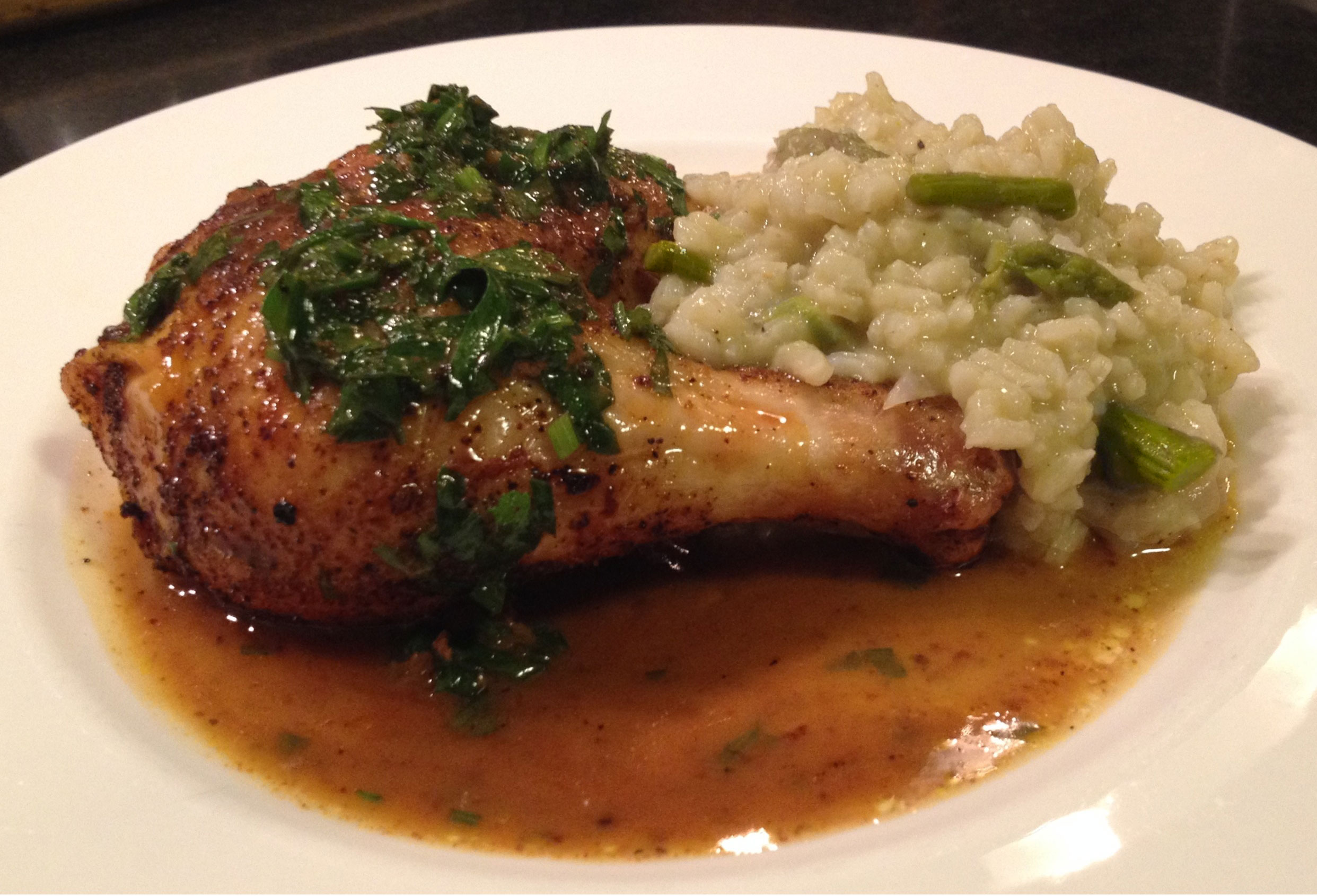 Roast chicken with a spice infused sauce with some asparagus risotto.