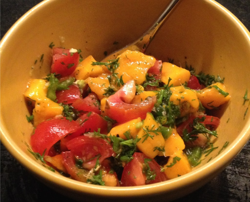 Mango tomato salsa in a yellow bowl.