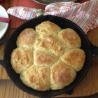 Biscuits baked in a cast iron skillet.