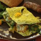 Spinach dip mix omelet piece.