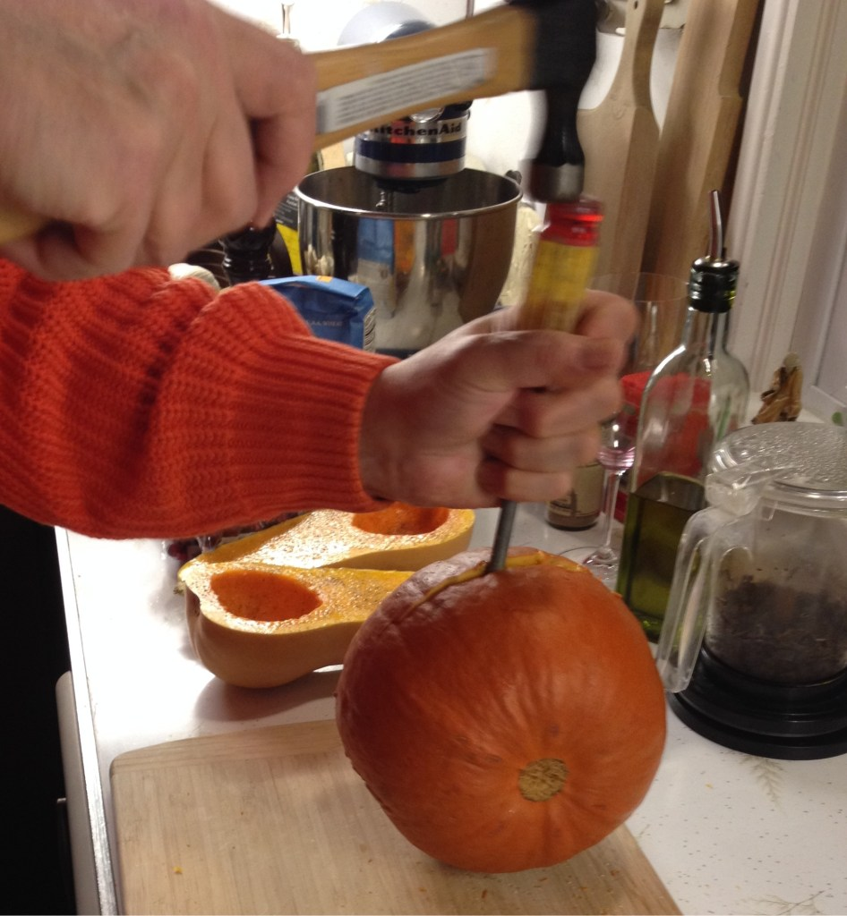 Cutting a pie pumpkin with a hammer and screwdriver.