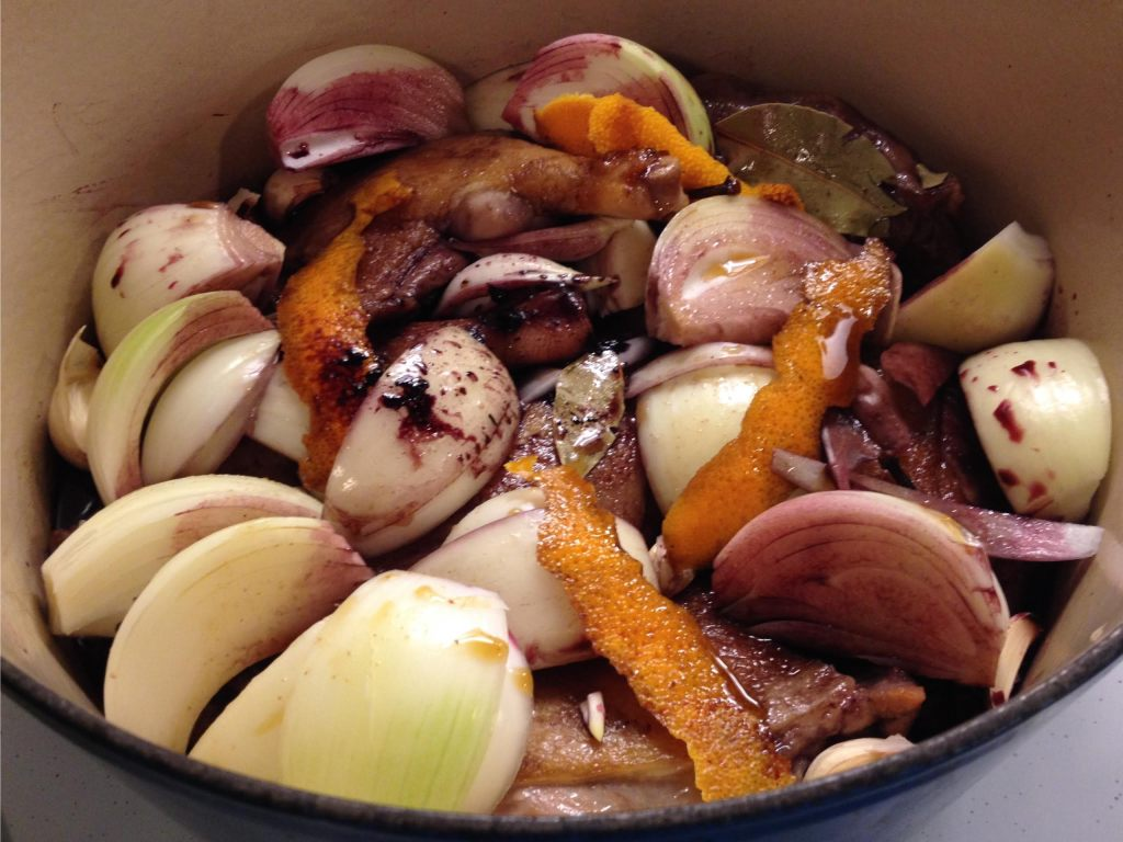 Duck braised with Red wine and Prunes ready for the oven in a Le Creuset pot.