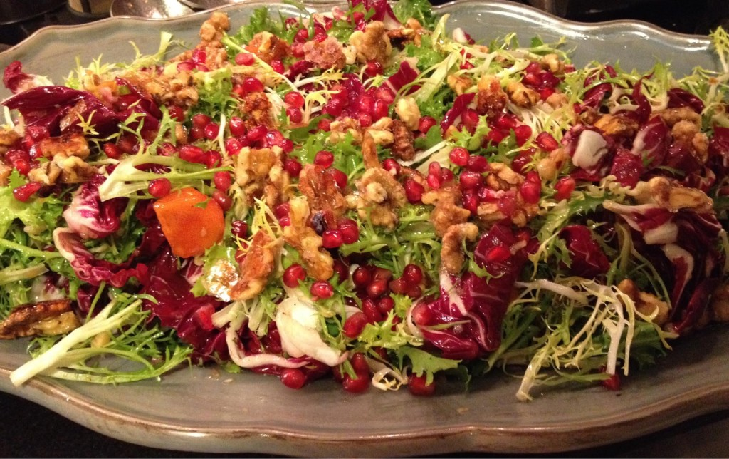 Persimmon pomegranate and frisee salad.