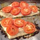 Lemon Sole roasted with leeks and tomatoes finished on pan.