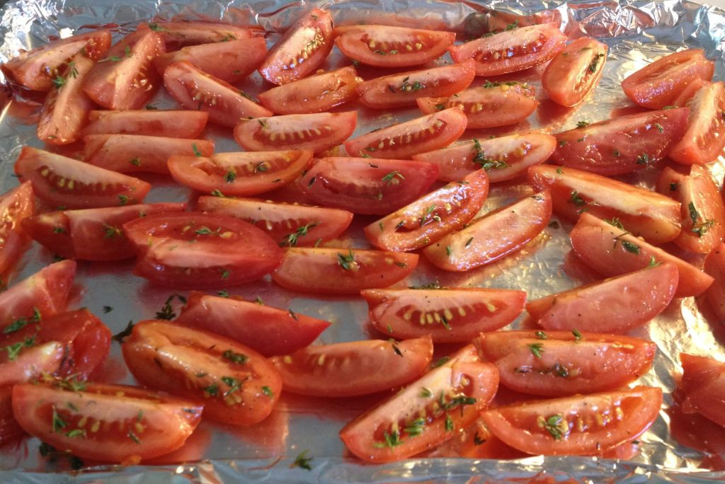 Roma tomatoes on the pan, ready to roast.