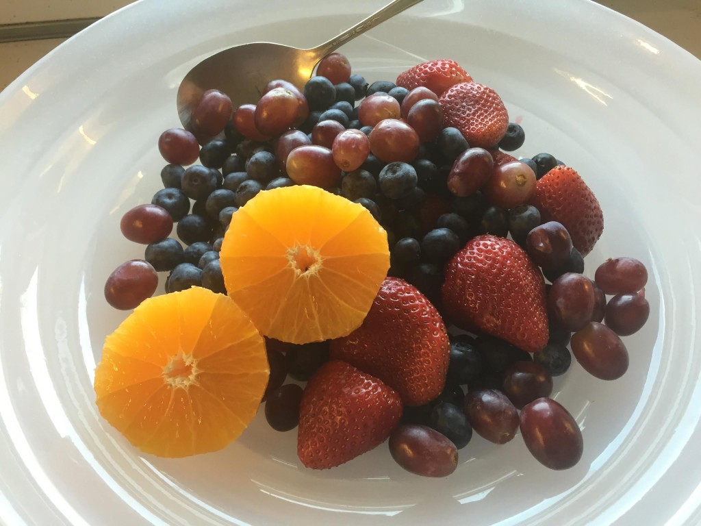Cit-trease - half oranges in a bowl of fruits.