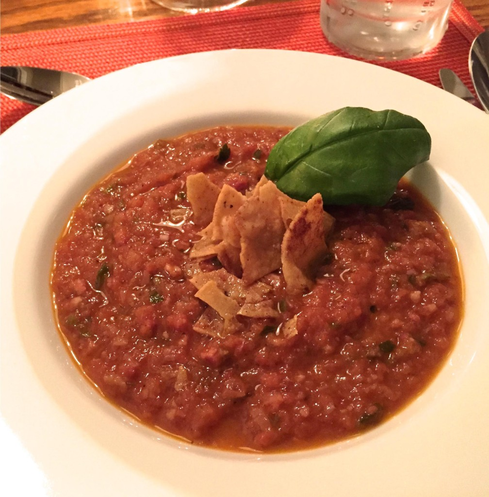 Smoked tomato soup in a white bowl.