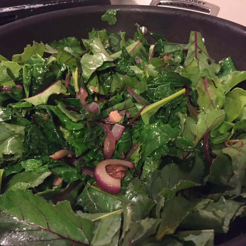 Maguey Sweet Sap with sauteed kale and beet greens in a skillet.