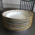 Stack of eight antique Limoges soup bowls.