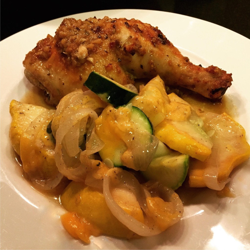 Easy cheesy sauteed squash with chicken on a plate.