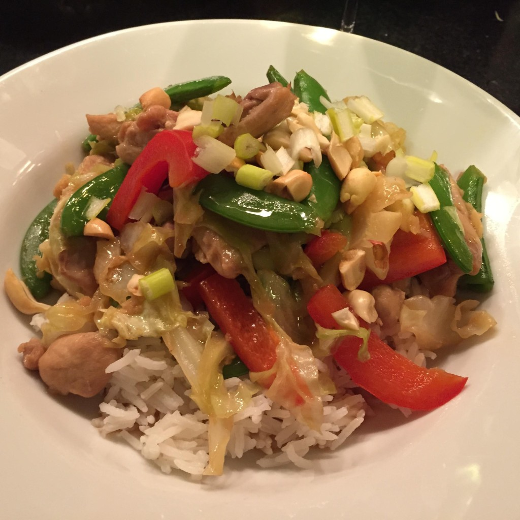 Super quick chicken and summer vegetable stir-fry  in a white bowl.