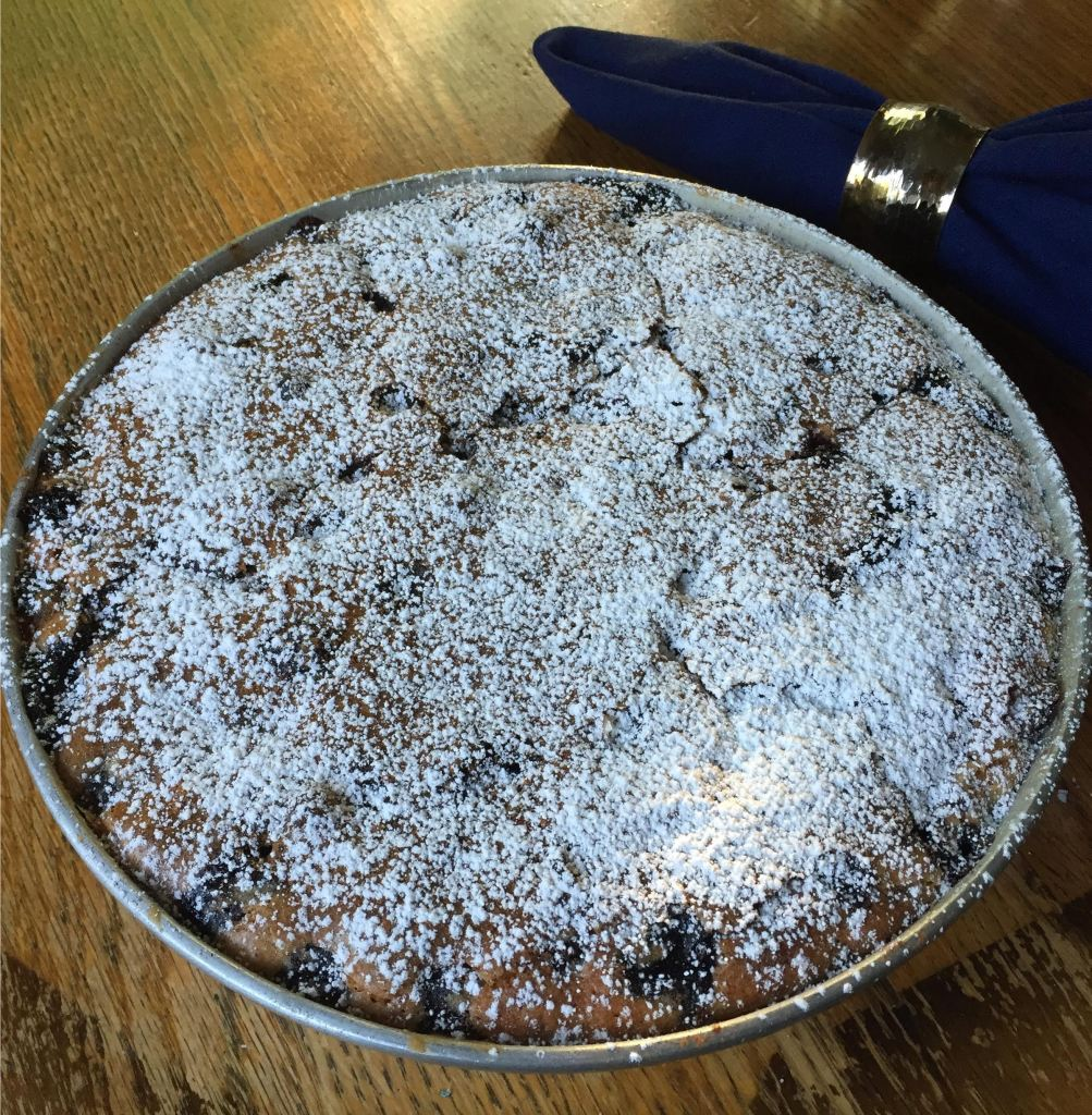 Blueberry Buckle finished with powdered sugar.
