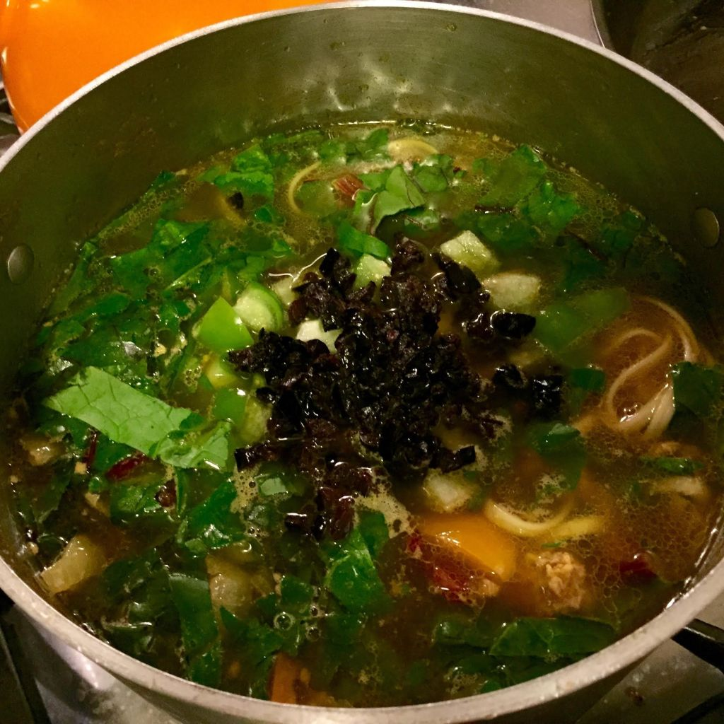 Curry pho with veal and veggies in a pot.