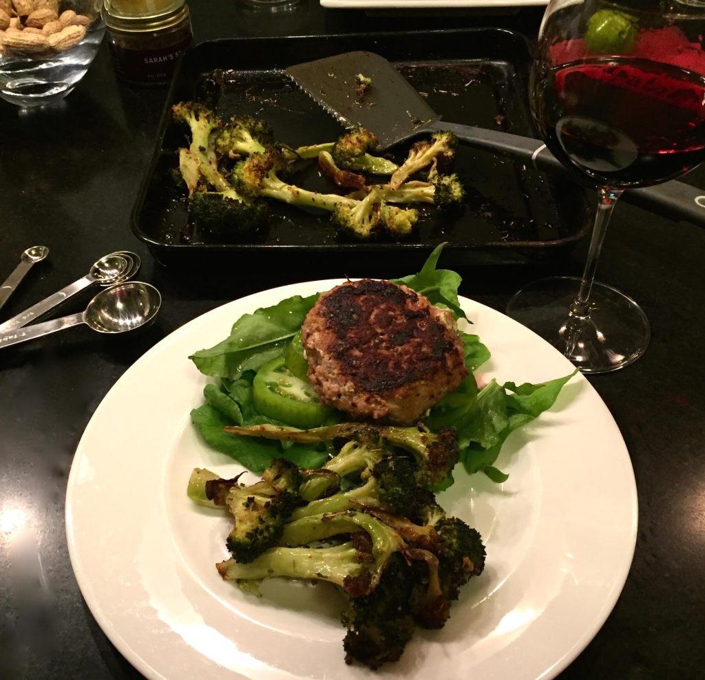 Tuscan Sea Salt on broccoli on a plate with a turkey burger.
