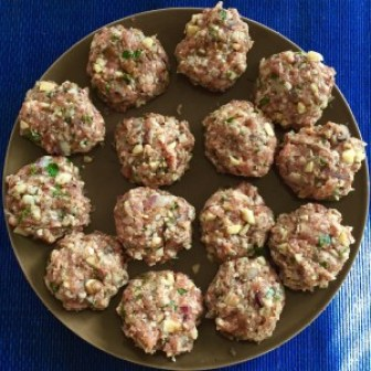 Delicious Sunday Morning Sausage Patties - raw patties on a brown plate.