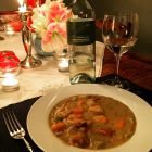 Pea soup in a white bowl.