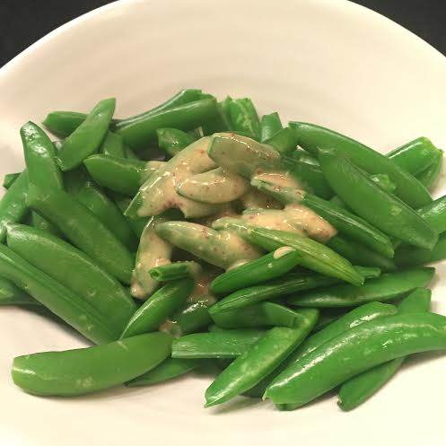 Dijon Mayonaise sauce on steamed sugar snap peas.