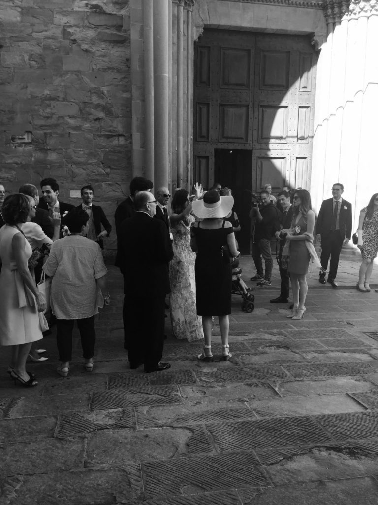 Guests waiting outside the church for the wedding to begin.