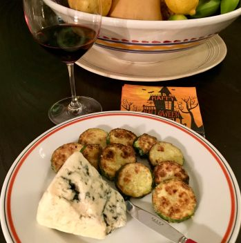 Zucchini slices breaded with finely ground Mom's Popped Lotus Seeds and Parmigiano cheese with a wedge of Roquefort cheese and a glass of red wine.