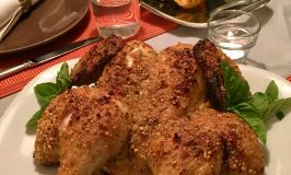 Quick nuts over fish mustard roasted chicken finished chicken on a white platter garnished with basil.