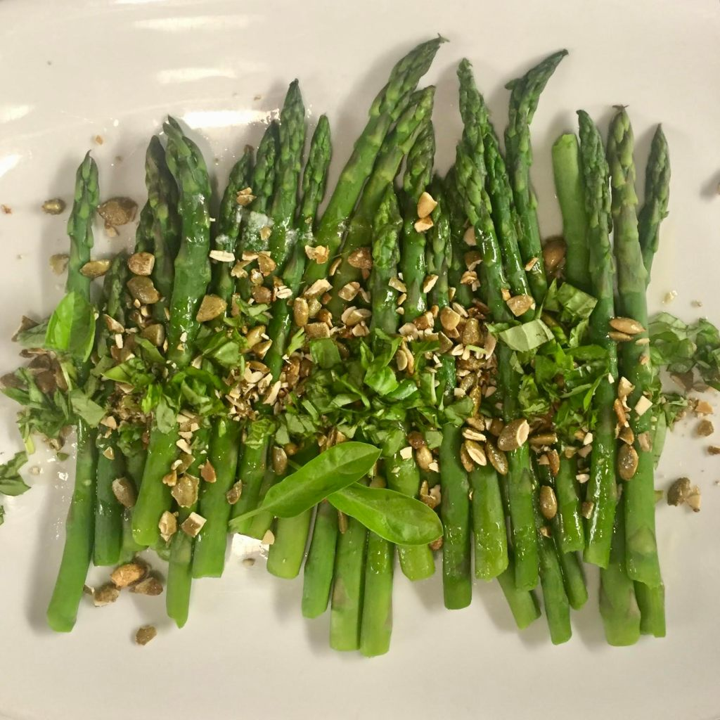 Chopped Maple Sugar & Sea Salt Superseedz on asparagus with chopped basil.