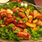 Super Quick Sausage, Potato & Arugula Recipe-close up shot on a blue French platter.