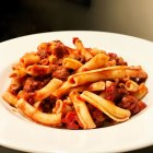 Quick Pasta with Sweet Sausage Bolognese in a white bowl.