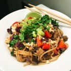 Get Dressed Sesame Sensation Roasted Eggplant Noodles - finished dish in a white soup bowl.