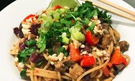 Get Dressed Sesame Sensation Roasted Eggplant Noodles - finished dish in a white soup bowl.