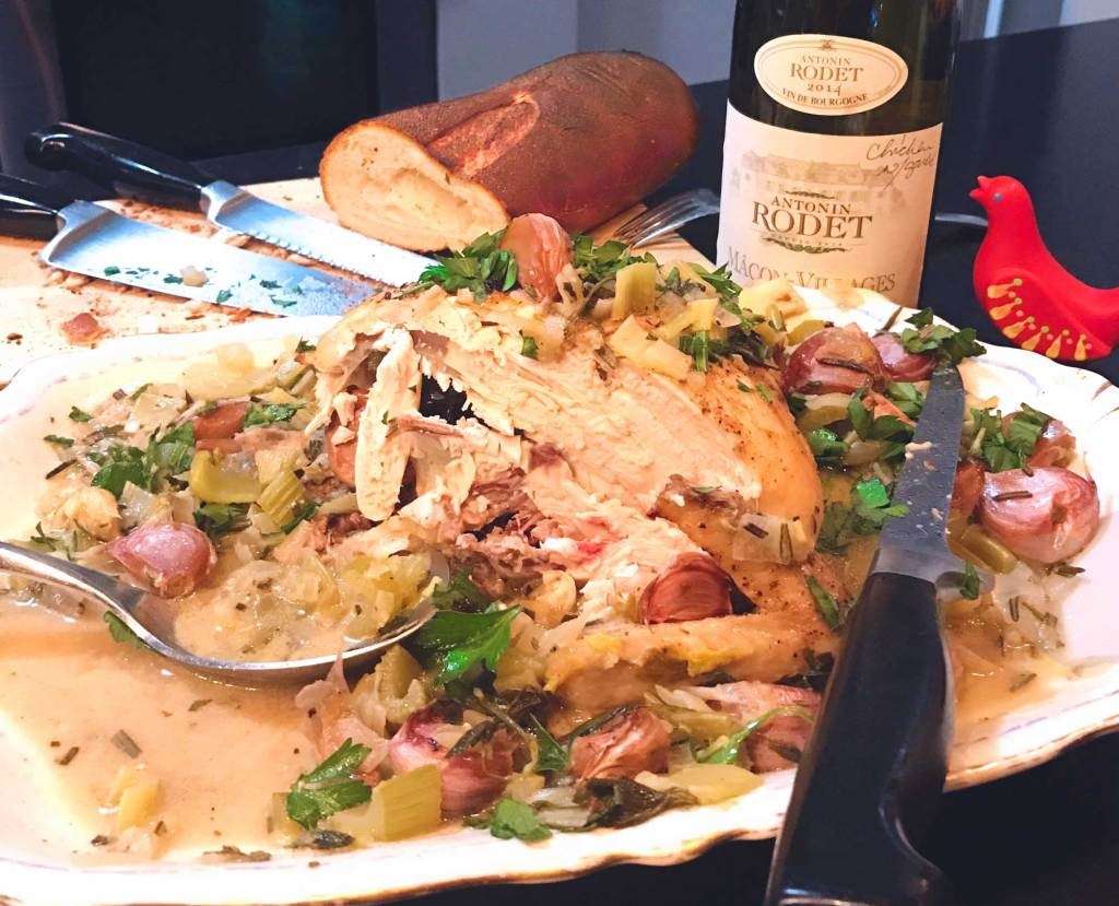 Joseph Joseph Smartbar with cut Chicken with 40 Cloves of Garlic, French bread and wine bottle.