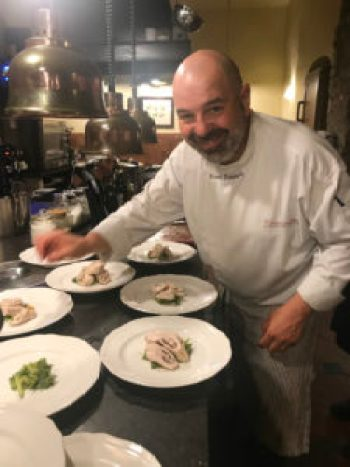 Franco Palandria plating the main dish.