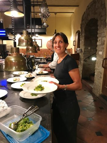 Paola plating and serving at Tuskcookany.