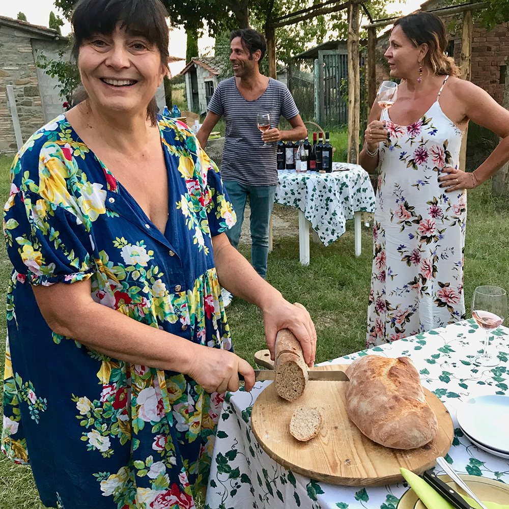 Marzia cutting her bread.