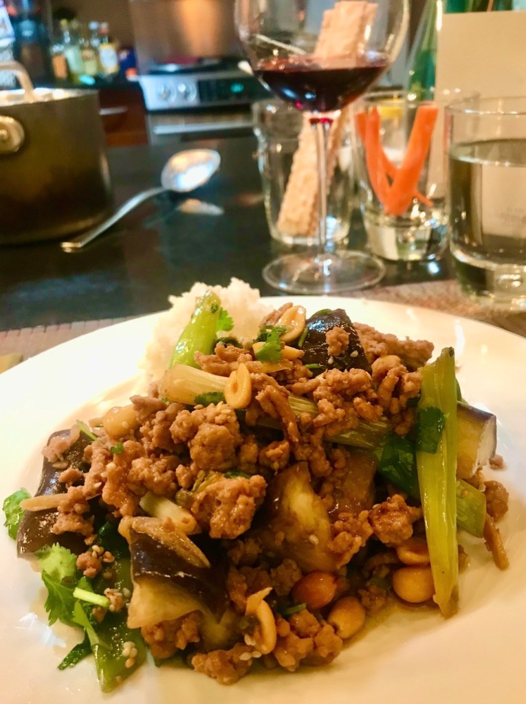 Pork with Ginger, Spring Onions and Eggplant – An Ottolenghi Recipe - served on a white plate with white rice.