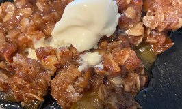 Rhubarb crisp with a scoop of ice cream.