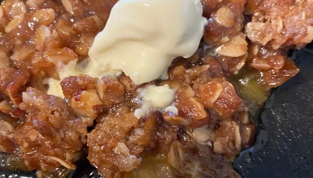 Rhubarb crisp with a scoop of ice cream.