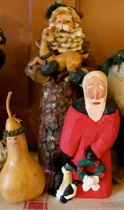 A gourd Santa, a rustic Santa, and Nickelson Claus