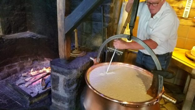 Chateau d'Oex cheesemaker at work making Etivaz AOP cheese - Credit: Deborah Grossman