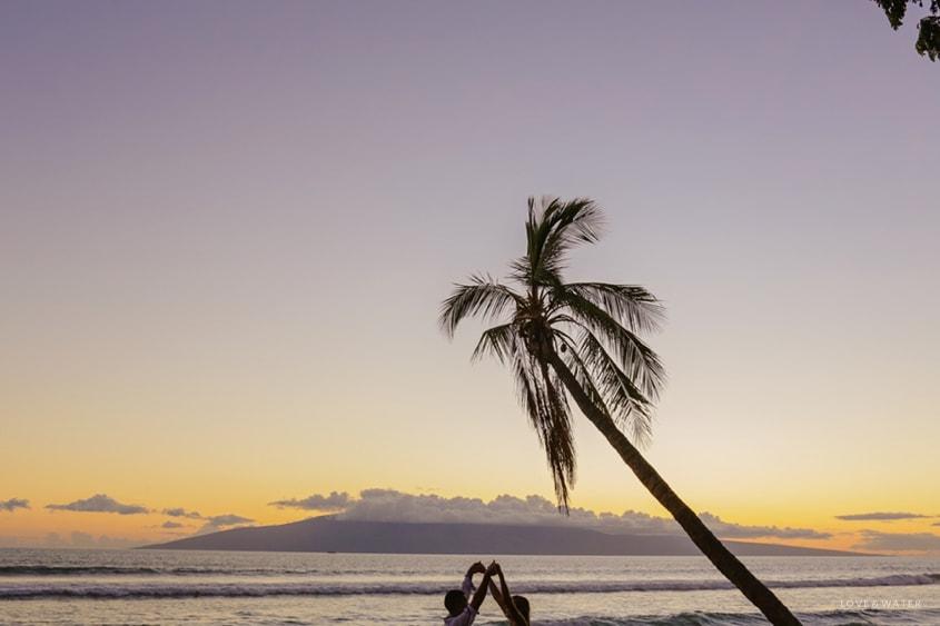 Maui surfboard wedding photography www.lovewaterphoto.com #maui #hawaii #elopement #surfboard #wedding #destinationwedding #sunset #weddingphotography