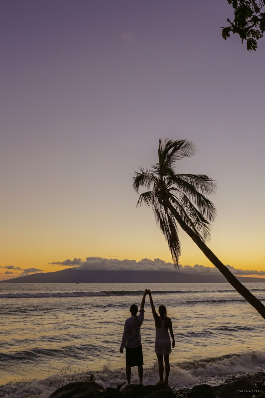 Maui surfboard wedding photography www.lovewaterphoto.com #maui #hawaii #elopement #surfboard #wedding #destinationwedding #weddingphotography #silhouette