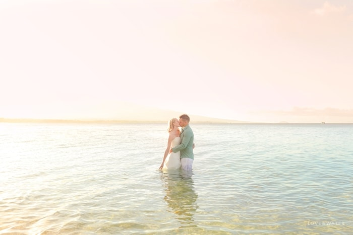 Trash the dress kiss Maui sunrise