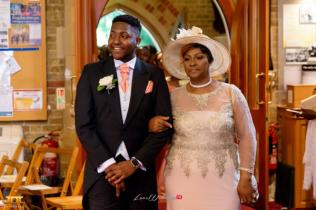 Ghanaian Wedding Mother walking down the aisle Bema and Cherelle Adjei-Ampofo JOT Photography LoveWeddingsNG