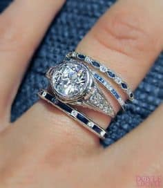 Love the classic combination of diamond and sapphire bands with an Art Deco engagement ring