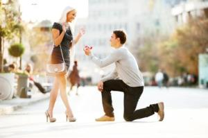 man on one knee proposing with ring