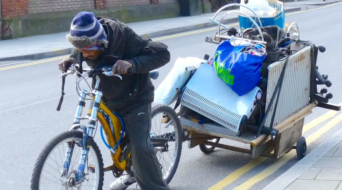 Poverty: cycling scrapdealer in Dalston Lane London E8 050314 © DavidAltheer@gmail.com