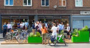 Glanville15: Hackney parklet, Cllr Philip Glanville facing camera with jacket, 67-69 Pitfield Street, Hackney N1 6BT, opens on Friday 3 July 2015 © DavidAltheer@gmail.com