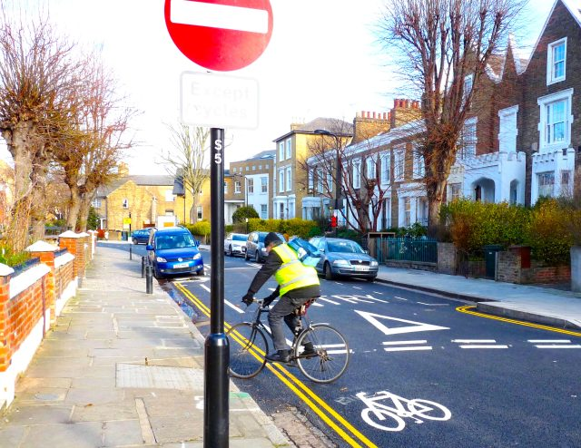 Cycleway©DA16: © david.altheer@gmail.com cyclist on unbarriered cycleway in Parkholme Road Dalston Hackney E8 heads for safety of the pavement 150216